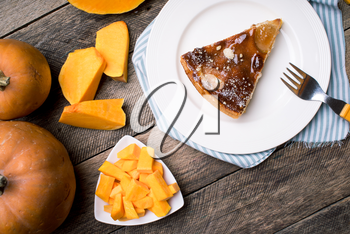 Pumpkin slices and piece of pie in Rustic style. Food photo