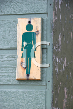 Royalty Free Photo of a Wooden Sign Outside a Women's Washroom