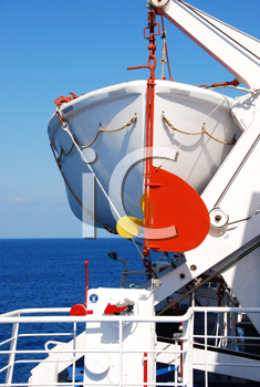 Royalty Free Photo of a Life Boat on a Ship in a Aegean Sea