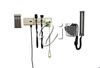 Medical diagnostic instruments mounted on the wall.
