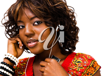 Royalty Free Photo of a Woman Listening to Music on an Mp3 Player