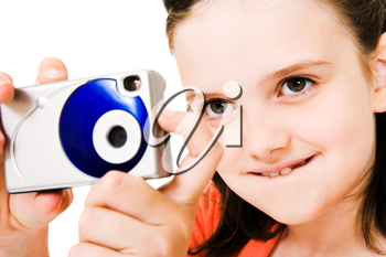 Royalty Free Photo of a Young Girl Posing with a Camera