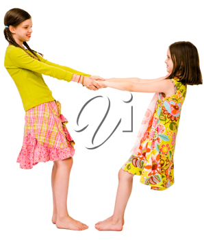 Royalty Free Photo of Two Young Girls Holding Hands and Spinning