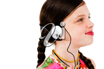 Royalty Free Photo of a Young Girl Listening to Music on Headphones