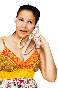Fashion model listening to music on headphones isolated over white