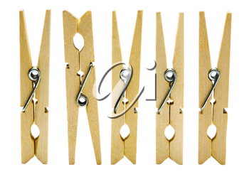 Close-up of wooden clothespins in a row isolated over white