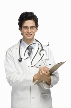 Portrait of a male doctor writing on a clipboard