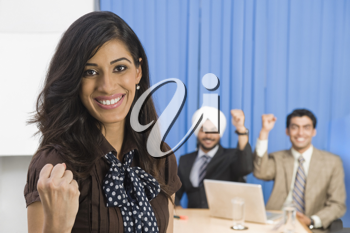 Business executives showing fist and smiling
