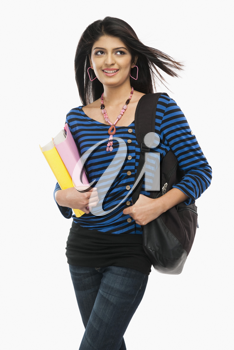 Female university student holding books and day dreaming