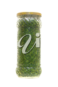 Tinned greens in a glass jar on a white background.