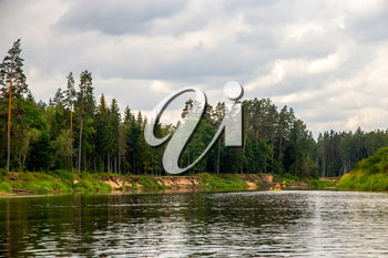 Landscape with cliff near the river Gauja, forest and sky. The Gauja is the longest river in Latvia, which is located only in the territory of Latvia.
