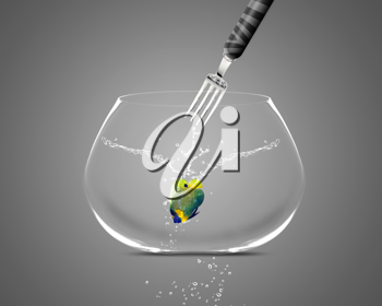Royalty Free Photo of a Fork Aiming Towards and Angelfish in a FishBowl