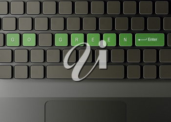 Royalty Free Photo of a Computer Keyboard With Go Green on the Buttons Symbolizing Ecology