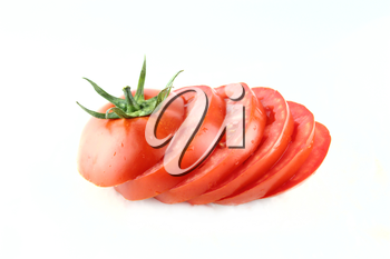 fresh tomatoes slices with green leaves on white background