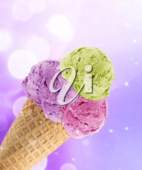 Delicious scoops of Ice cream in the cone with abstract light background.