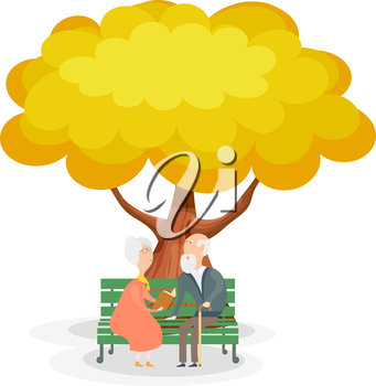 Old men on the bench. Elderly couple on a park bench under the yellow autumn tree. 