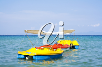 Royalty Free Photo of Peddle Boats on the Ocean