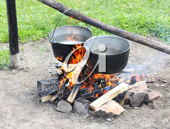 Royalty Free Photo of Two Pots Over a Campfire