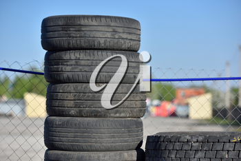 Old used and dirty tires, warehouse, stacked upright