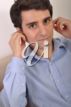 Royalty Free Photo of Man Listening to Music