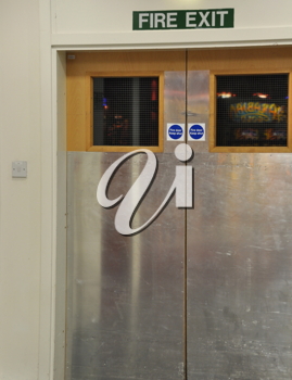 Royalty Free Photo of a Fire Exit Door on an Airport Building