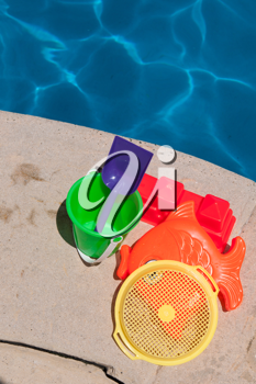 Royalty Free Photo of Toys By the Poolside