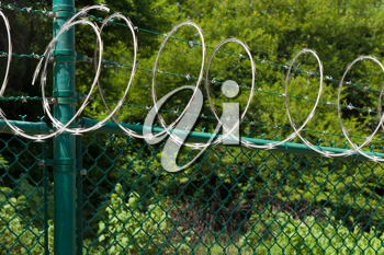 Royalty Free Photo of a Barbed Wire Fence