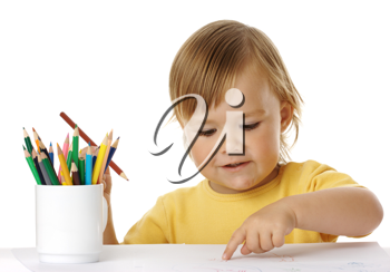 Royalty Free Photo of a Little Girl Drawing With Pencil Crayons