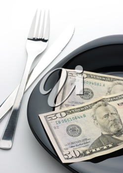 Royalty Free Photo of Money on a Plate With a Knife and a Fork