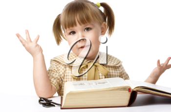Royalty Free Photo of a Little Girl With a Big Book