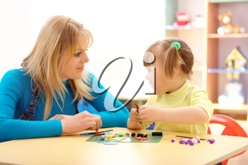 Royalty Free Clipart Image of a Teacher and Child