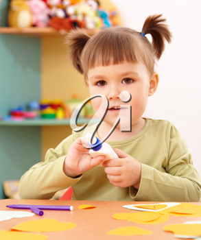 Royalty Free Photo of a Little Girl Doing a Craft in School