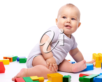 Royalty Free Photo of a Little Boy Playing With Building Blocks