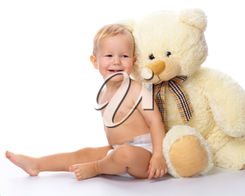 Royalty Free Photo of a Child With a Soft Teddy Bear