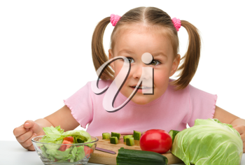 Royalty Free Photo of a Little Girl Preparing Salad