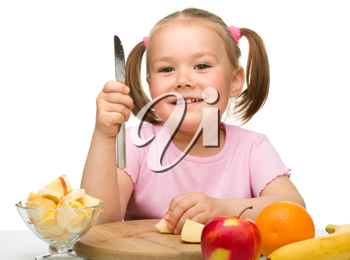 Royalty Free Photo of a Girl Cutting Food