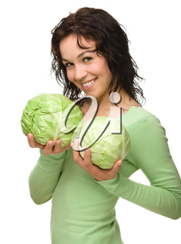 Royalty Free Photo of a Girl With a Cabbage