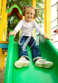 Royalty Free Photo of a Little Girl on a Slide
