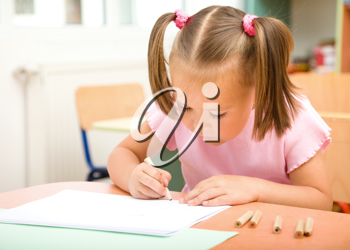 Royalty Free Photo of a Little Girl Colouring
