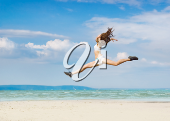Royalty Free Photo of a Leaping Woman at the Beach