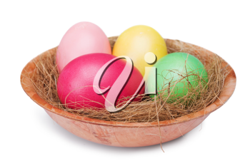 multicolored Easter eggs  in a nest isolated on a white background