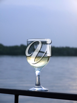 Royalty Free Photo of a Glass of Wine With Water in the Background