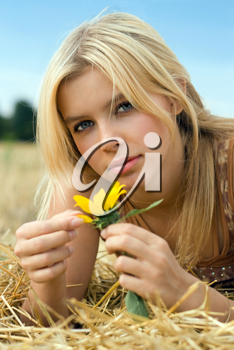 Royalty Free Clipart Image of a Woman Tearing Petals Off a Flower