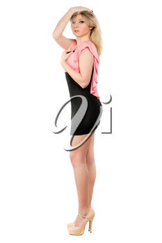 Pretty young woman wearing beige shoes and cocktail dress. Isolated on white