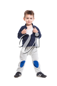 Smiling little boy posing in sport clothes. Isolated on white