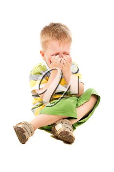 Little blond boy in shorts and t-shirt crying. Isolated on white