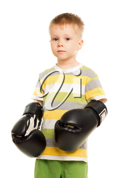 Little funny boy posing with the boxing gloves. Isolated on white