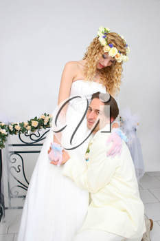Royalty Free Photo of a Couple Posing on Wedding Day