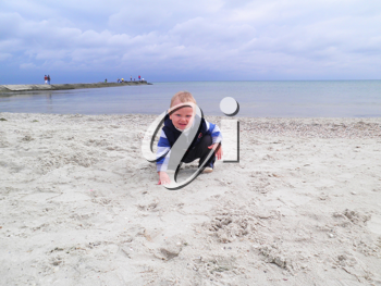 Royalty Free Photo of a Little Boy at the Beach