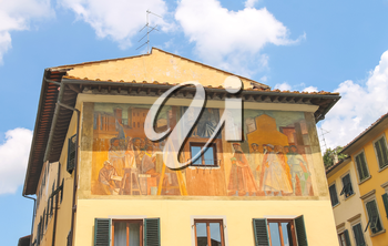 Facade of house is decorated with wall paintings. Florence, Italy